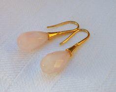 Øreringe med facetslebne rosa quartz dråber