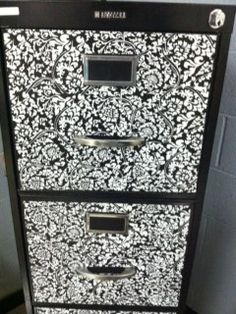 Filing cabinet and black bookshelves... Build more for under whiteboard... Never enough shelves...