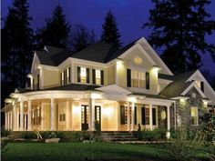 A country/colonial style home ... are you liking the wrap-around front porch?