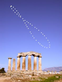 (9:00am local time) from January 7-December 20, 2003 analemma. A foreground base exposure of the Temple of Apollo in ancient Corinth, Greece, was digitally merged with the film image. Equinox dates correspond to the middle points (not the intersection point). The fall equinox sun is at the upper midpoint near picture center. Summer and winter solstices are at analemma top and bottom. -Anthony Ayiomamitis (TWAN)