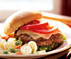 For more pizza flavor, spoon a little pizza sauce over these mozzarella-topped beef burgers.