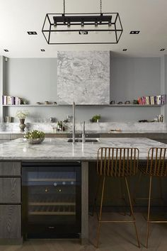 A marble hood? This clean contemporary kitchen with open shelving is incredible. Hale House was Designed by De Rosee Sa Stylish Kitchen, New Kitchen, Kitchen Dining, Kitchen Decor, Kitchen White, Decorating Kitchen, Kitchen Ideas, Hale House, London Apartment