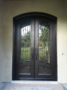 Just installed this eye catching, arch top, custom, wrought iron door.  It screams curb appeal to the max!  iron doors. front doors. entry doors. custom doors. home remodel. home building ideas.