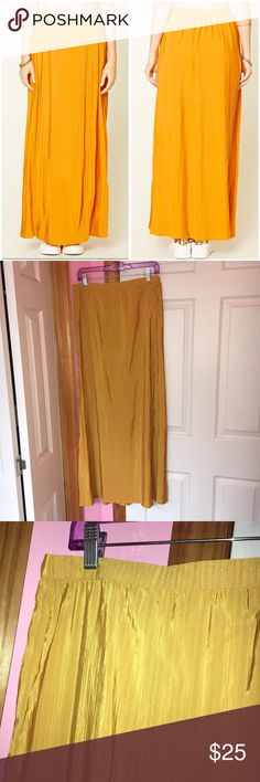 """Forever 21 Mustard Accordion Pleated Maxi Skirt Only tried on and has been washed. Color is a mustard color. Accordion pleated skirt. Elasticized back waistband. 100% polyester. Laying flat waist is approx 29"""" and length is approx 40.5"""". Stock photos from Forever 21 website. ❌NO TRADES❌ Forever 21 Skirts Maxi"""
