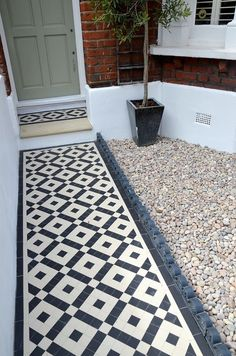 front garden Plastered rendered front garden wall painted white metal wrought iron rail and gate victorian mosaic tile path in black and white scottish pebbles York stone balham london Front Garden Path, Front Path, Garden Paths, Terrace Garden, Garden Pool, Victorian Front Garden, Victorian Terrace House, Victorian Porch, Terrace House Exterior