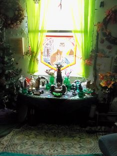 I recently got some pictures of my altar and wanted to share with you all. Although after all of the gorgeous altars I've seen on here lately, I'm afraid mine seems pretty cluttered! A bit of background info: Cats are very important to me spiritually, so most of my shrine is dedicated to Bast…