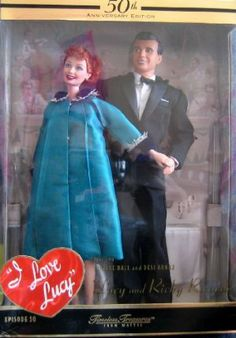 """I Love Lucy 50th Anniversary edition by Mattel. $79.65. For Adult Collector; Ages 14+ Years. Great for any collection, as a gift or for fun play!. Includes: Lucy Doll approx. 11.5"""" tall w/reddish hair & blue eyes, a Ricky Ricardo Doll approx. 12"""" tall w/dark molded hair & brown eyes. Lucy Doll wears a green Coat Dress w/blue velvet & silver collar & cuffs, a Slip, a pair of faux """"diamond"""" Earrings, & blue hi heel Shoes. Ricky Doll wears a black Tuxedo style Suit, a white S..."""