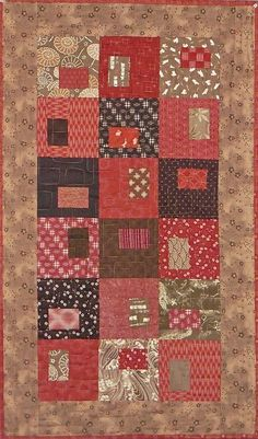 This quilt features many cotton fabrics, including textured dobby prints, imported from Japan. Print motifs include bunnies, cherry blossoms, ocean waves, parasols and dragons, as well as traditional sashiko designs. Colors are rich barn red and shades of warm brown. This pattern is called Gems and was designed by Janine Burke Designs. My store sample is being sold with permission. The machine quilting in a free motion wave design was done in a coordinating variegated thread and can be seen…