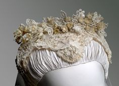 Grace Kelly's veil headpiece, designed by Helen Rose, Juliet cap decorated with lovebirds, orange blossoms.