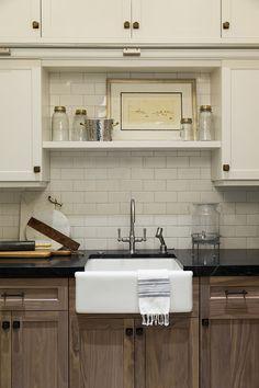 laundry storage, farmhouse sink, open shelving, cabinets, brass hardware
