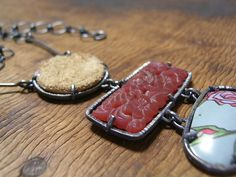 Leather, resin and tin necklace by flux play; I really like the simple prong setting for these pieces