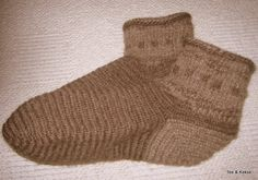 """Socks were made in two nalbinding stitches. """"The entire lower part is worked in [Mammen] stitch, the [cuff] is needled in the so-called Tarim. For the first time I have here also a subtle pattern incorporated. The material I use when naalbinding prefer pure wool."""" <3 Methods of construction for nalbinding socks http://www.shelaghlewins.com/reenactment/naalbinding/sock_construction.htm"""