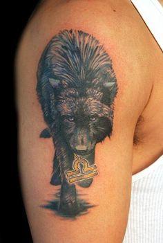 oooo I like the idea of the wolf carrying the zodiac symbol alot