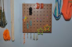Great cute way to hang your jewelry using pegboard.