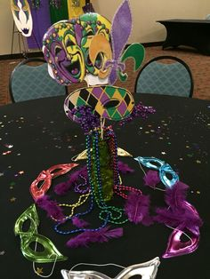 Mardi Gras Decor Centerpieces...Mardi Gras mask cutouts, with beads and masks