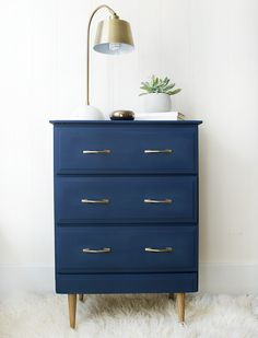 A curbside piece of junk gets turned into a stunning navy nightstand with a modern flare, using new hardware and new legs!