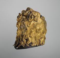 Sallet in the Shape of a Lion's Head Date: ca. 1475–80 Culture: Italian Medium: Steel, copper, gold, glass, pigments, textile Dimensions: H. 11 3/4 in. (29.8 cm); W. 8 1/4 in. (21 cm); D. 12 1/2 in. (31.8 cm); Wt. 7 lb. 14 oz. (3574 g)