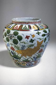 Jar with a scene of fish in a lotus pond  China, Ming dynasty, Jiajing (1522-1566)  Porcelain with underglaze and overglaze multicolor decoration, wucai, H. 9 1/2 in   Asian Art Museum, B60P17