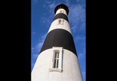 """Cape Hatteras Lighthouse.  Built in 1870 to warn ships away from a sandbar dubbed, """"The Graveyard of the Atlantic.""""  National Parks lead tours up its 269 cast iron steps.  There is even a full-moon tour."""