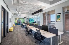 """The open area benching system is organized in """"pods"""" and provides immediate adjacency to meeting spaces and collaboration areas. Corporate Interior Design, Corporate Interiors, Conference Room Design, Glass Partition, Waiting Area, Soft Seating, Co Working, Break Room, Software Development"""