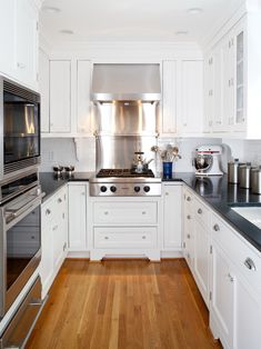 Gorgeous Kitchen for a smaller House or condo/townhome. Love the wood flooring, Stainless steel range & Hood & Beautiful White Cabinetry that goes to the ceiling - great for maximum storage!