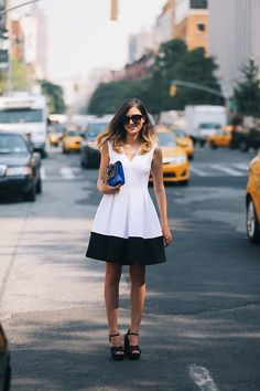 Be a modern Marilyn in a structured monochrome dress.
