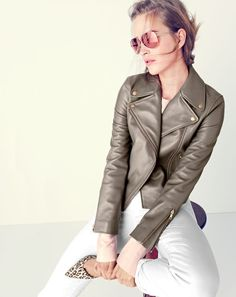 J.Crew women's Collection leather motorcycle jacket, Collection silk top with stitching, stretch toothpick Cone Denim® jean in white, Jill sunglasses and Colette d'Orsay pumps in safari print.