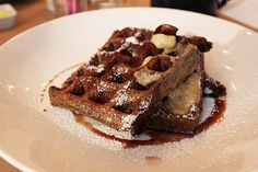 PUBLIC Blood pudding waffles with foie gras butter and red wine–poached pears