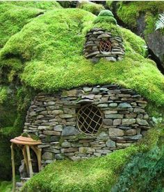 Stone and grass house with sod-style green roof