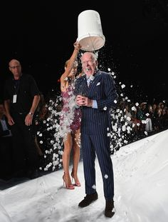 At the Project Runway show, Tim Gunn gets hit with
