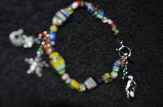 Multi-Colored Bracelet with Charms    Now ONLY $8!! Come check out my Yardsellr today, before it's gone!!!