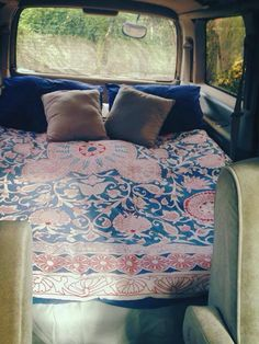 Turn the back of a van into a bedroom for a long roadtrip....