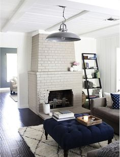 Love the colors...so relaxing.  Love the painted brick fireplace contrasting with the floor.  Love the ceiling.  Love that rug! I could definitely hang out here