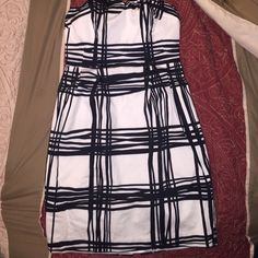 Express strapless dress Beautiful Express black and white strapless dress for work or play.  Size 2 dress with pockets and the length is 26 inches.  In the front of the dress there is a small stain (see last picture) it is barely noticeable. Express Dresses Mini