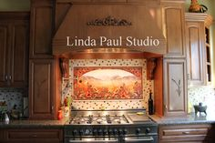 I like all of this except the small squares in the bordering tiles. Sunflower Kitchen backsplash Linda Paul
