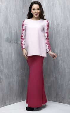 EMEL X DAPHNE IKING - LONGHORN - Modern A-line Baju Kurung with Lace (Pink) This A-line modern baju kurung is all about the class and simplicity with border lace on the sleeves. Also, the top is a tweed inspired fabric that's makes a lovely ensemble with the border lace. #emelxCLPTS #emelxDaphneIking #emelbymelindalooi #bajuraya #bajukurung #emel2016 #raya2016 #DaphneIking #lace #pink #moden #2016 #baju #kurung #baju #raya