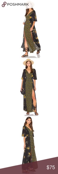 HP!!BAND OF GYPSIES Floral Maxi Black with Yellow Florals, Flowy Bell Sleeves, V-Neck, Unlined with Two Sexy Slits in front. Hand wash cold, line dry. Material: 100% polyester TRADING PAYPAL Band of Gypsies Dresses Maxi