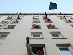 Bulent KILIC :: Protestors chant slogans as they stand at the windows of the DISK (Confederation of Revolutionary Trade Unions of Turkey) building in Istanbul, May 2010 Istanbul Pictures, May Days, Istanbul Turkey, Closed Doors, Photo Art, Windows, World, Building, Places