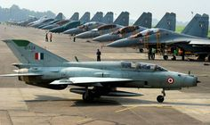The past and the future: A MiG 21 parks alongside Su-30MKIs.