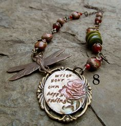 """""""Write your Own Happy Ending"""" My inspiration was Erin's focal pendant. I found so carnelian and czech beads to match the dark red of the rose. I love the thought of """"writing my own happy ending""""."""