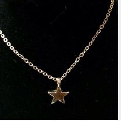 Dainty Delicate gold rising star necklace gold plt Comes with card. 18 kt gold plt star necklace with adjustable length. Price is firm no trades Sherri Souza Jewelry & Boutique Jewelry Necklaces