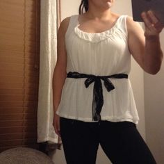 """White tank top with belt loops Great basic white tank top with belt loops, no belt, I like to tie various ribbons through as belts, cute layered with a cardigan, will fit up to 44"""" bust, fit is loose so it could easily fit a large too, length is 25"""" ANTONIO MELANI Tops Tank Tops"""
