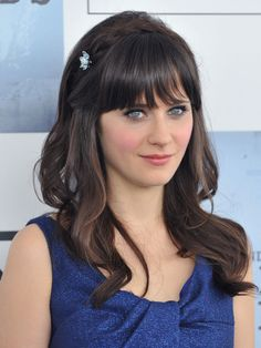 Take a cue from Zooey Deschanel and fasten your crown braid with a sparkling floral pin to add an extra pretty flair.