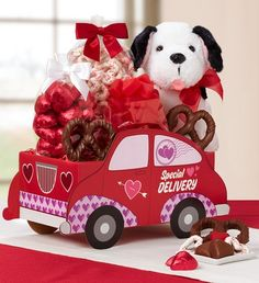 Send someone this Special Delivery Valentine's Sweets Sedan - Candy, chocolates and an adorable plush puppy! $29.99