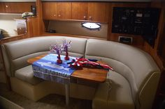 This Leatherette dinette seats 4 and converts to sleeper. Notice the solid cherry table.