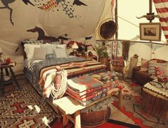 Ralph Lauren's decorated teepee (love the rugs, stacked blankets & horses)