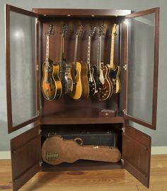 Guitar Case - drew covi covi Thatguy Check this out. I think we could re-purpose a storage unit without too much work to make you a guitar display. Guitar Display Case, Guitar Storage, Guitar Rack, Guitar Stand, Cool Guitar, Ideas Armario, Home Music Rooms, Guitar Cabinet, Music Decor