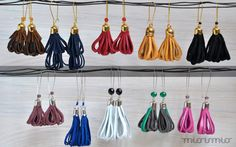 Eco friendly earrings with scrap leather tassels by missismiss