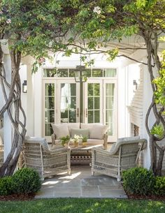 PATIO IDEA : OUTDOOR FIREPLACE : FRENCH DOORS : LANTERN PENDANT LIGHT : WALL LANTERN SCONCES : BLUE STONE : BOXWOODS : Giannetti Home New Project: The Wisteria Residence