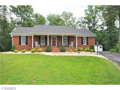 Red brick ranch home pictures.